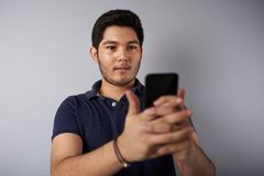 Young man hold smartphone Stock Photography