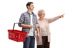 Free Young Man Holding A Shopping Basket With Elderly Woman Pointing Royalty Free Stock Photo - 89960035