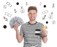 Young man holding American dollars and credit card against white background with. Drawn money stock photography