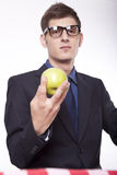 Young man holding an apple. Young man holding an green apple Royalty Free Stock Photography
