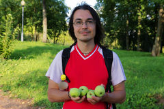 Young man holding apples in his hands Royalty Free Stock Photo