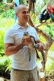 Young man holding baby alligator,Jungle Island,Miami,2014 Royalty Free Stock Photos