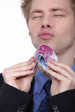 Young man holding bank notes. Young man holding conspicuously bank notes Stock Image