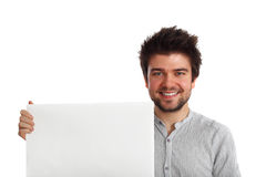 Young man holding a banner. Young attractive man holding a blank banner with a friendly smile Stock Photos