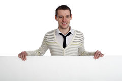 Young man holding a banner Royalty Free Stock Image