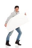 Young man holding banner. Royalty Free Stock Photography