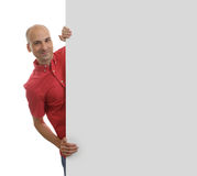 Young Man Holding Banner. Isolated on white background Royalty Free Stock Image