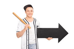 Young man holding a baseball bat and an arrow Stock Images