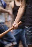 Young man holding baseball bat. Stock Photos