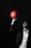 Young man holding basketball ball Royalty Free Stock Photo