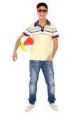 Young man holding beach ball Stock Photography
