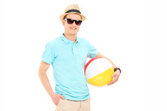Young man holding a beach ball Royalty Free Stock Photography