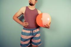 Young man holding a beach ball Royalty Free Stock Photos