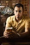 Young man holding beer. Royalty Free Stock Images