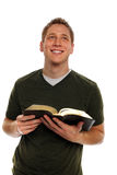 Young Man Holding Bible Royalty Free Stock Photo