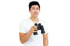 Young man holding binoculars Royalty Free Stock Photography