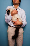 Young man holding Birman cat Stock Photography