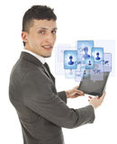 Young man holding a black tablet with social friends Royalty Free Stock Photo