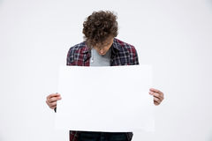 Young man holding blank billboard Stock Image