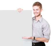 Young man holding blank billboard Stock Photo