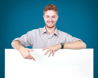 Young man holding blank billboard Stock Images