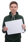 Young man holding blank billboard Royalty Free Stock Image