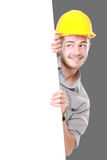 Young man holding blank billboard wearing hard hat Stock Photography
