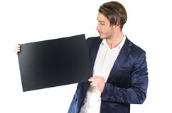 Young man holding blank black board or sign Royalty Free Stock Photos