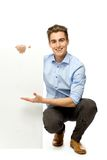 Young man holding blank board Stock Photos