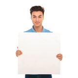 Young man holding a blank board Stock Photography