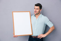 Young man holding blank board Royalty Free Stock Image