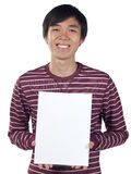 Young man holding a blank canvas Royalty Free Stock Photos