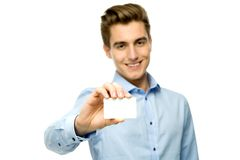 Young man holding blank card Royalty Free Stock Images