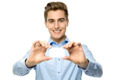 Young man holding blank card Stock Photography