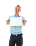 Young man holding blank card Royalty Free Stock Photo