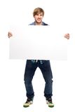 Young man holding blank paper Royalty Free Stock Photography