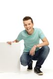 Young man holding blank placard Royalty Free Stock Photo