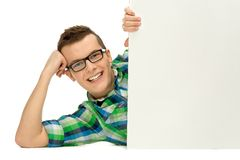 Young man holding blank placard Stock Photography