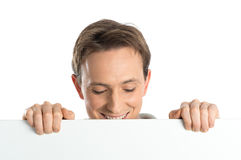 Young Man Holding Blank Placard Royalty Free Stock Photos