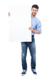 Young man holding blank placard Royalty Free Stock Images