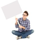 Young man holding blank poster Royalty Free Stock Photos
