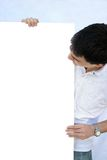 Young man holding blank sheet. Space for your text Royalty Free Stock Photography