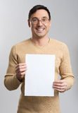 Young man holding a blank sheet Stock Image