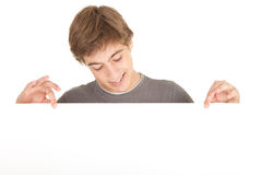 Young man holding blank sign Royalty Free Stock Photos