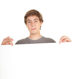 Young man holding blank sign. poster Royalty Free Stock Images
