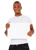 Young man holding blank white sign Royalty Free Stock Photography