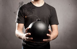 Young man holding a bomb Royalty Free Stock Photo