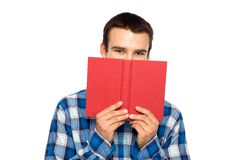 Young man holding book Stock Photography