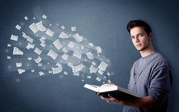 Young man holding book Stock Photo