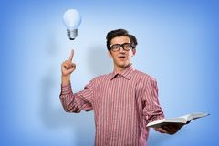 Young man holding a book Royalty Free Stock Image